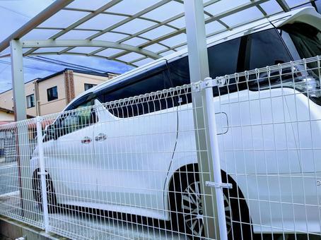 White minivan parked in a carport