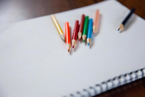 Colored pencils and notes