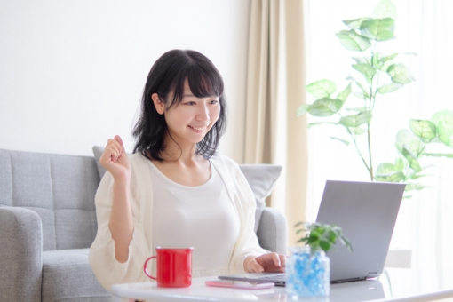 Image of a young woman opening a laptop