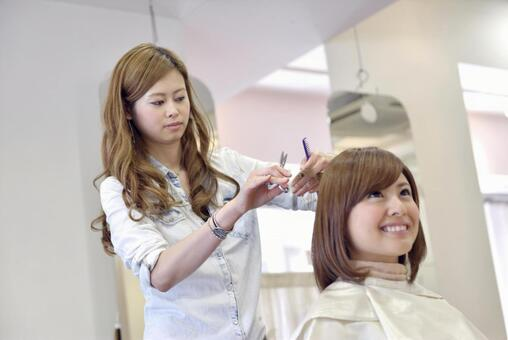 Hair cutting in hairdressing room 28