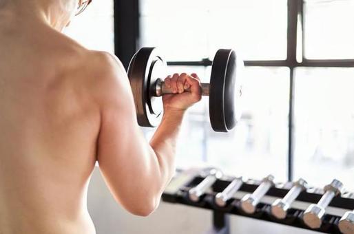 Asian man lifting dumbbells backwards