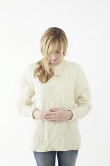 Woman holding a stomach 4