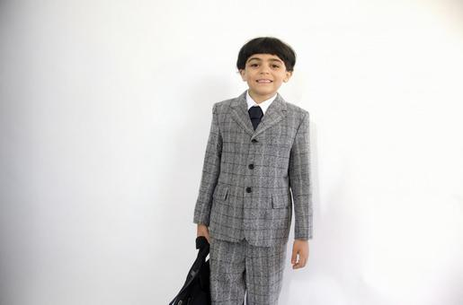 Child with a suit with a bag 1