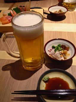 Beer at a sushi bar
