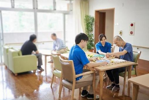 Elderly people and caregivers recreation in nursing care facilities