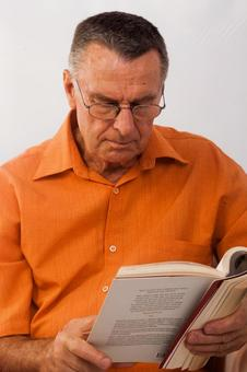 Male reading book 3