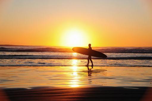 First sunrise of Kujukuri beach and surfer