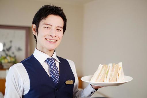 Hotel man with a sandwich 6