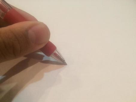 Hand with red ballpoint pen 6 (left handed)