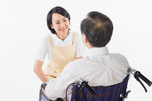 Nurse and wheelchair male 18