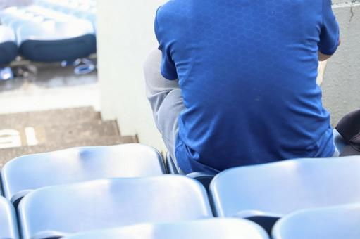 Men watching sports in the audience ③