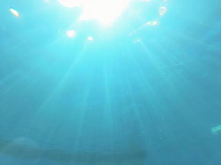 Okinawa blue sea background / glitter water texture