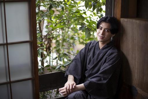 Yukata man sitting by the window