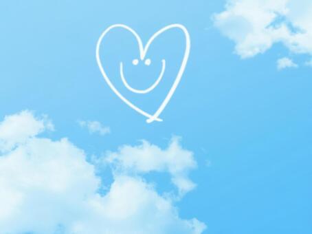 Heart's smile in blue sky