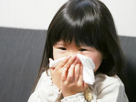 Girl blowing nose 2