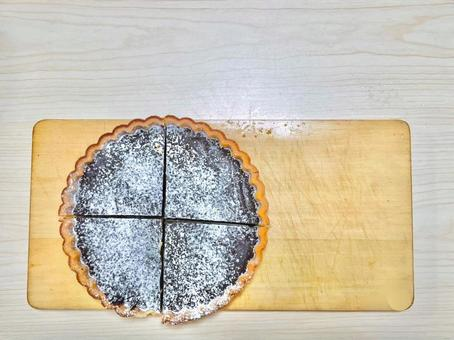 Chocolate tart and cutting board