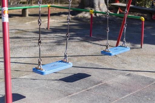 Colorful children's park playground equipment swing