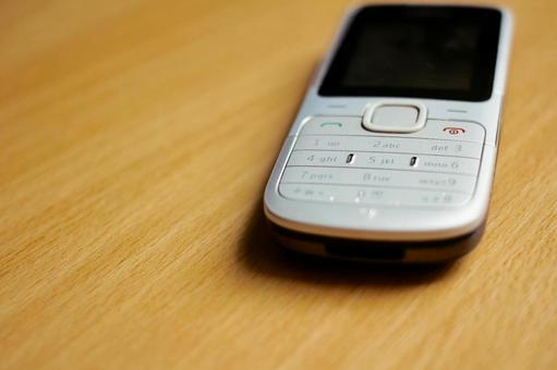 Mobile phone on desk 1