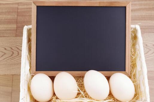 Blackboard and eggs in a basket