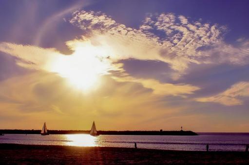 Yacht illuminated by the setting sun