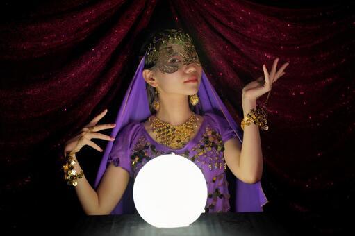 Female fortune-teller doing crystal fortune-telling