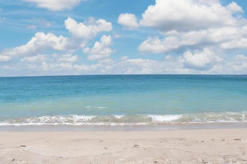 Clear blue sea Blue sky and cumulonimbus clouds White sand beach Summer image