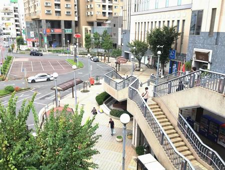 Overlooking the entrance to a suburban station in Tokyo.