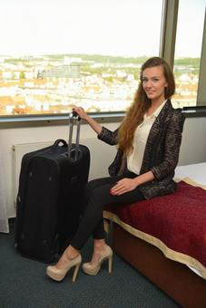A woman sitting on a hotel bed 4
