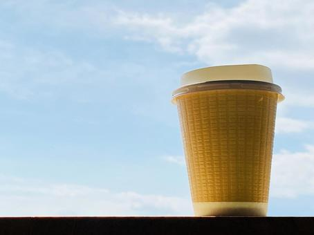 1 beige coffee paper cup and blue sky