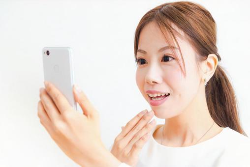 Surprised woman 2 looking at smartphone