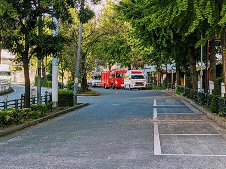 Fire trucks and ambulances parked on the road