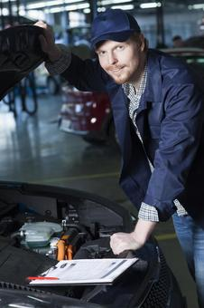 Automobile mechanic checking bonnet 5