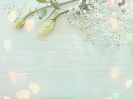White flowers and heart glitter frame wood grain background
