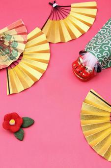 Folding fan, lion dance and plum