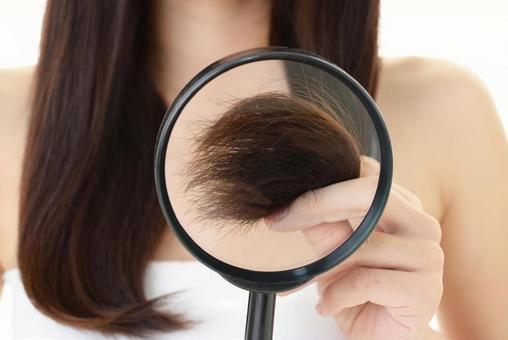 Woman suffering from damaged hair