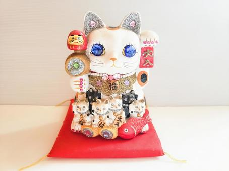 Maneki Neko with red cushion