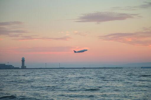 An airplane flying over the sea