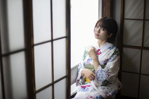 Yukata woman with a glance by the window