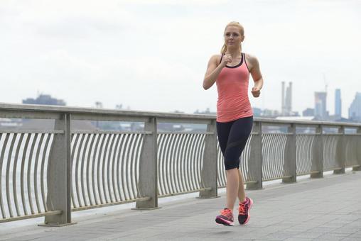 A woman running along a river 13