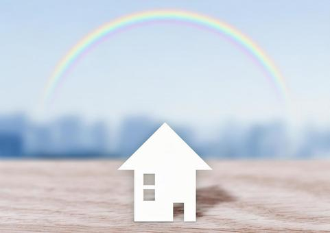 Image of house and rainbow City background