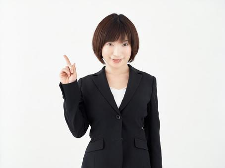 Female OL who poses 1 pointing pose on white background