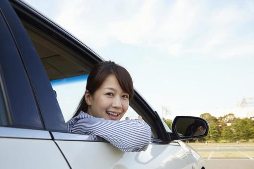 A woman taking a face from the window of a car 6