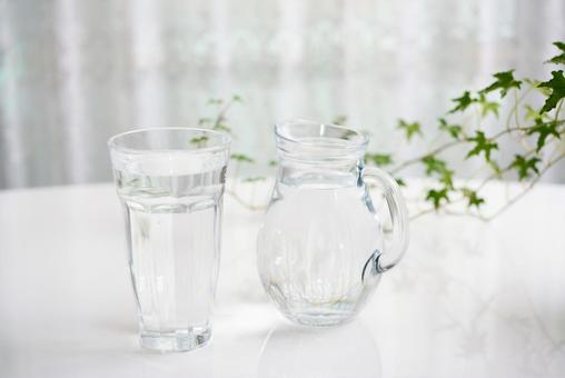 Water and pitcher on the table