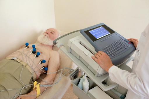 A foreign elderly man 1 who is taking an electrocardiogram 1