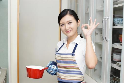 Woman enjoying cooking