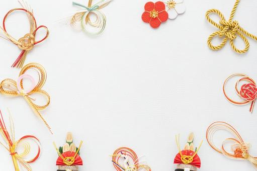 White paper background surrounded by mizuhiki work Kadomatsu and gold knotted gold string New Year's material