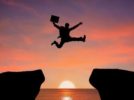 Businessman who jumps at dusk