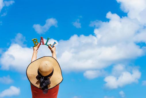 Bali travel image Woman and blue sky