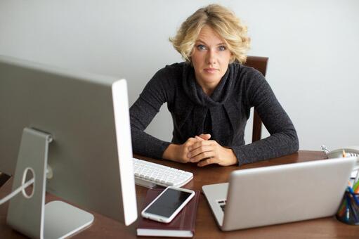 Working mother 6 sandwiched between desktop computer and laptop computer 6