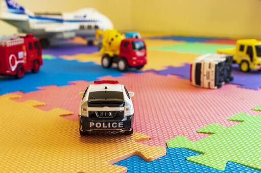 Vehicle toys cluttered on the mat